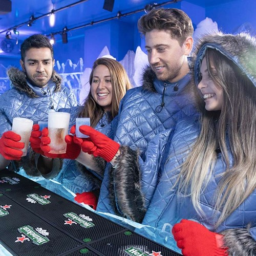 Four people toasting at the Berlin Icebar.